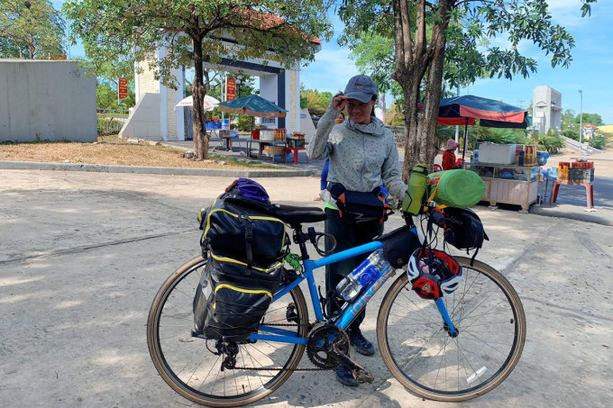 Trang and her bicycle in Quang Tri in July 2020.