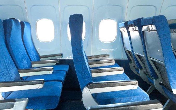 Lý do không phải ghế máy bay nào cũng có cửa sổ